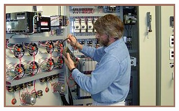 Technician performing meter calibration